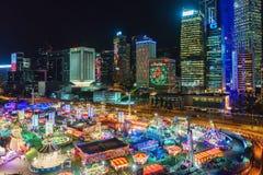 AIA wielki Europejski karnawał w Środkowym Harbourfront w Hong Kong Noc pejzaż miejski, Hall Zdjęcie Stock