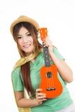 Aian kobieta cieszy się jej ukulele Zdjęcie Royalty Free