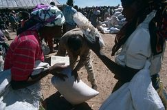 Aid distribution in displaced peoples camp, Angola. Aid distribution by NGO CARE workers at a camp for displaced people in Angola Royalty Free Stock Images