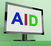 Aid On Monitor Shows Aiding Help Or Relief Royalty Free Stock Photography