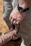 Aid worker's hands holding children's hands royalty free stock images