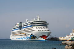 AIDA Cruise Ship. AIDA Diva Cruiseliner in the port of Rhodos, Greece. Logo is a smiling mouth/lips on the front and eyes on both sides of the ship Royalty Free Stock Image