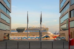 The AIDA Cruise ship to see between two office buildings in Hamburg Royalty Free Stock Photos