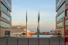 The AIDA Cruise ship to see between two office buildings in Hamburg Royalty Free Stock Images