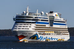 AIDA Dive Cruise Ship in Bar Harbor, USA, 2015. The cruise ship AIDA Diva with it's characteristic logo of lips and eyes on both sides of the ship in the bay of Royalty Free Stock Images