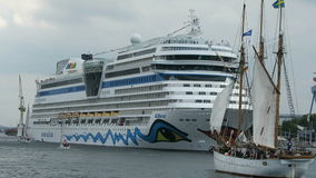 Aida mar cruise ship in harbor of Warnemuende during Hanse Sail event. Germany stock video footage