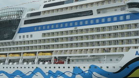 Aida mar cruise ship in harbor of Warnemuende during Hanse Sail event. Germany stock footage