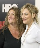Aida Turturro and Edie Falco. Actresses Aida Turturro and Edie Falco, arrive on the red carpet for the New York premiere of HBO`s multi-part drama, `The Deuce Stock Photo