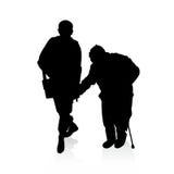 Aidant un vieil homme - silhouettes de vecteur illustration stock