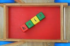 Aide écrite avec des cubes Images stock