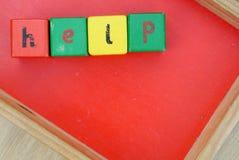 Aide écrite avec des cubes Image libre de droits