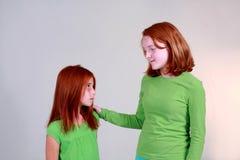Aide de grande soeur Image libre de droits