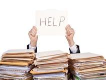 Aide - homme d'affaires surchargé Image stock