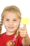 Aide memoir. A little girl showing a sticky note (place for your own text) on her thumb Stock Images