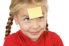Aide memoir. A little girl with a sticky note (place for your own text)  on her forehead Stock Images