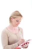 Aide personnel prenant des notes image stock