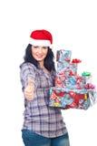 Aide réussie de Santa donnant des pouces Photos stock