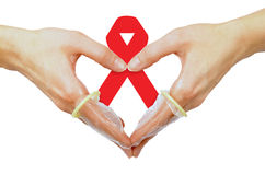 Aids. Hands with aids ribbon and condoms isolated on white Stock Photos