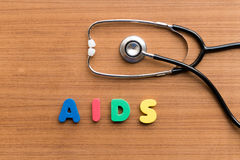 Aids. Colorful word on the wooden background Stock Photos