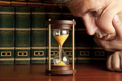 AIDS concepts. Man looking at hourglass royalty free stock images