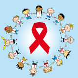 Aids day. Group of childrens around a ribbon Royalty Free Stock Images