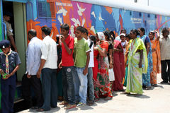 AIDS/HIV awareness campaign-india. Local people wait outside Red Ribbon Express to see the exhibits of the Indian Railways AIDS/HIV awareness campaign. on June royalty free stock photos
