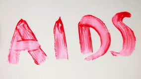 Aids in red paint being crossed out Royalty Free Stock Photography