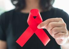 Free Aids Red Ribbon On Woman`s Hand Support For World Aids Day And National HIV/AIDS And Aging Awareness Month Concept Royalty Free Stock Photography - 186156977