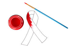 Aids ribbon. Pot of red paint and paintbrush.  Unfinished royalty free stock photography