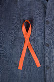 AIDS ribbon fastened on clothing Royalty Free Stock Photography
