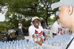 AIDS WALK 2010. NEW YORK - MAY 16: Volunteers given away bottled water to the people participating to the AIDS Walk 2010 on Riverside Drive on May 16, 2010 in Royalty Free Stock Images
