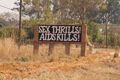 Aids warning sign Africa. Warning sign by road saying sex thrills aids kills, in Zambia, Africa royalty free stock photo