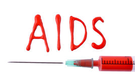 AIDS word and syringe with blood Royalty Free Stock Images