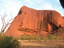 Aiers Rock in  the middle of the Australian continent. The red rock  - monolit -in the dessert i holly to the aboriginal people which have een living  here for Stock Images