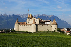 Aigle Castle, Switzerland. Aigle Castle (French: Chateau D'Aigle) is situated in the middle of vineyards in Canton Vaud in Siwtzerland Royalty Free Stock Image