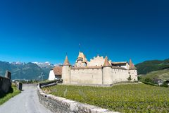 Aigle, VD / Switzerland - 31 May 2019: the historic castle at Aigle in the Swiss canton of Vaud with summer vineyards. The historic castle at Aigle in the Swiss stock photo