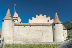 Aigle, VD / Switzerland - 31 May 2019: the historic castle at Aigle in the Swiss canton of Vaud with summer vineyards royalty free stock images