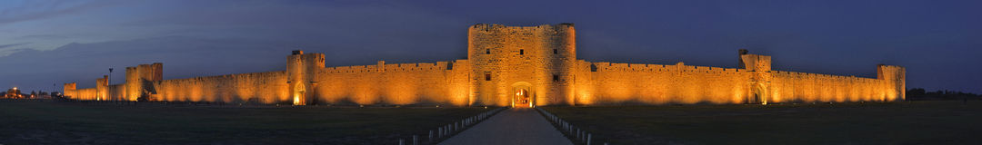 Aigues Mortes Castle by night. Panoramic view by night of Aigues Mortes, a fortified city in provence Stock Image