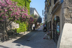 Aigues-Mortes (France). AIGUES-MORTES, FRANCE, JUNE 8, 2015: Aigues-Mortes (Gard, Languedoc-Roussillon, France), the medieval city. Typical street with woman Stock Images