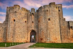Aigues-Mortes, Gard, Occitania, France: the city gate in the med. Aigues-Mortes, Gard, Occitania, France: the ancient city gate between the ramparts of the walls royalty free stock images