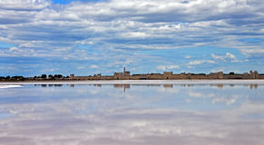 Aigues-Mortes reflected in salt lagoon Royalty Free Stock Images