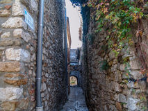 Aigueze. Alley in the village of Aigueze, Languedoc-Roussillon, France Royalty Free Stock Image