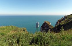 Aiguille of Belval and Etretat cliffs stock photography