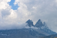 Aiguille d'Arves mountain range in the clouds at sunset, Ecrins, Royalty Free Stock Image