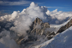 Aiguille du Midi in the clouds Stock Photo