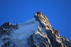 Aiguille du Midi in the evening sun, Mont Blanc massif, Chamonix-Mont-Blanc, French Alps, France. stock image