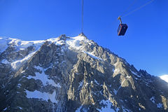 Aiguille du Midi and funicular, French Alps, France. Aiguille du Midi is a mountain in the Mont Blanc massif within the French Alps. It is a very popular tourist Stock Images