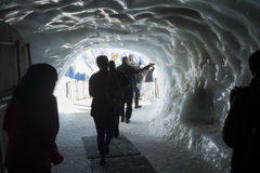 Aiguille du Midi ice tunnel. CHAMONIX, FRANCE - SEPTEMBER 02: Tourists in ice tunnel in Aiguille du Midi complex. At 3842 meters, the complex offers close views Stock Images