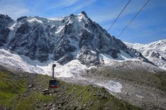 Alps Mountains. Aiguille du Midi, mountain in the Mont Blanc massif, landmark attraction in France. Alps Mountains. Cable car to the Aiguille du Midi, with Stock Images
