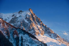 Aiguille du Midi mountain peak. Highlighted by sunset light Royalty Free Stock Images